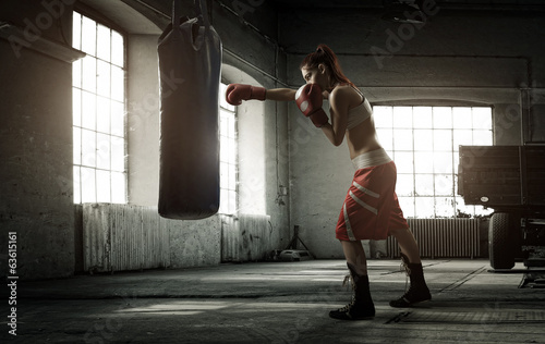 Foto op Canvas Vechtsport Young woman boxing workout in an old building
