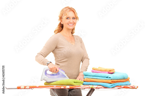 Mature woman ironing clothes