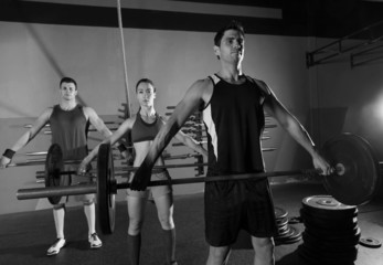 Barbell weight lifting group workout exercise gym.