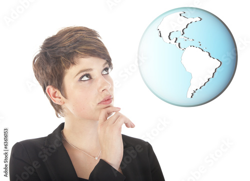 Young woman looking at earth globe isolated on white background