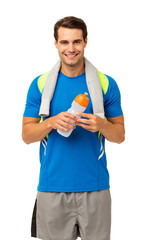 Happy Young Man With Towel And Water Bottle