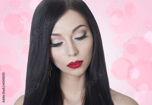 brunette with long eyelashes