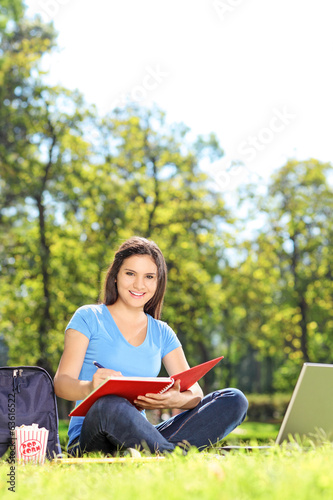Female student relaxing outdoors