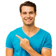 Happy Young Man Pointing Over White Background
