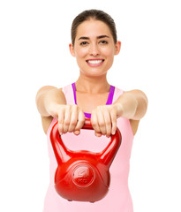 Happy Young Woman Exercising With Kettle Bell