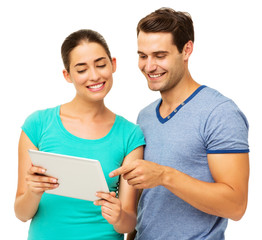Happy Couple Using Digital Tablet