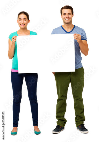 Happy Young Couple Holding Billboard