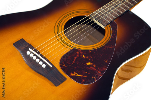 Acoustic sunburst guitar top with six strings isolated