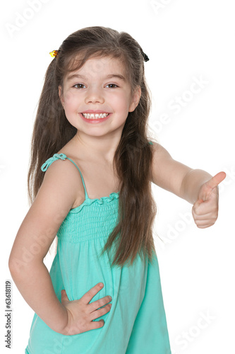 Little girl holds her thumb up