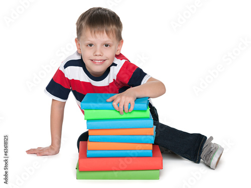 Smiling cute boy with books