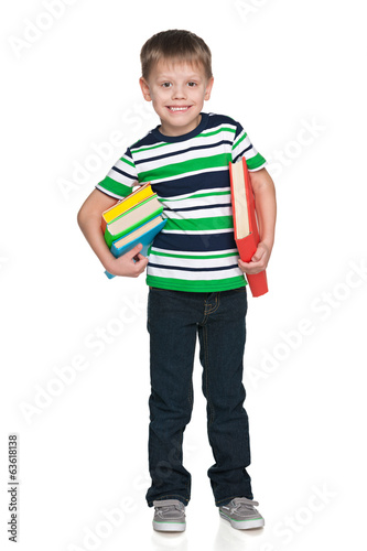 Cute little boy with books