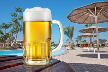Mug of light beer outdoor. Summer