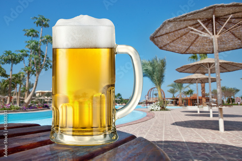 Mug of light beer outdoor. Summer