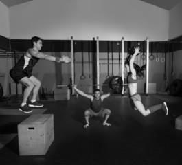 gym group workout barbells slam balls and jump