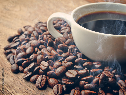 smoke and roasted coffee  on grunge wooden background