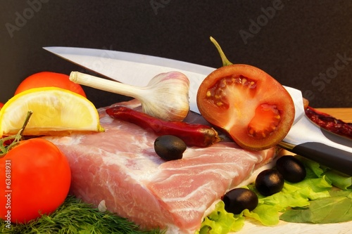 Still Life with Meat, Tomato and Knife on Cutting Board