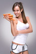 Healthy lifestyle! Beautiful woman holding lot of carrots