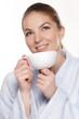 Junge Frau mit  Teetasse..