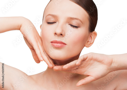 Young woman touching her face