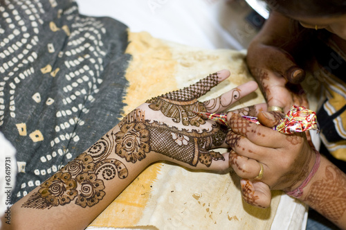 applying henna on hand, wedding ,Rajasthan, India