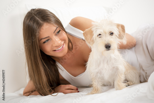 Cute girl and dog in the morning