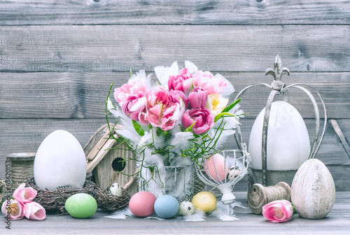 Easter decoration with flowers and colored eggs