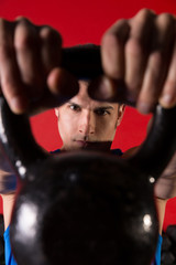 Kettlebell man portrait looking through the handle