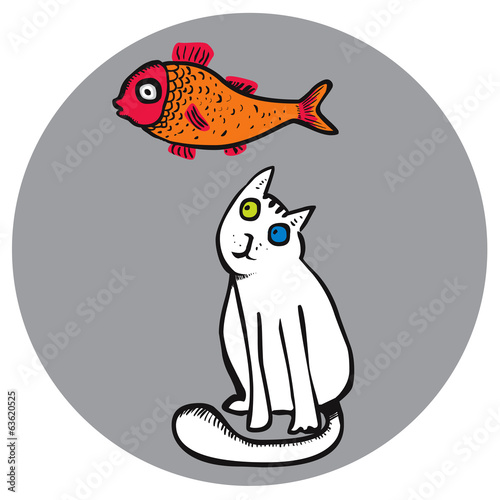 Funny cat looking at goldfish