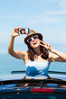 Woman taking selfie photo on car summer vacation