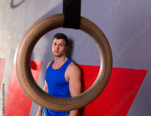 Man gym ring view relaxed after gym workout on wall