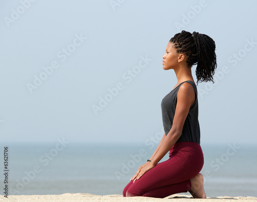 Woman meditating at the seaside