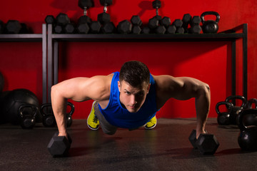 push-up strength man hex dumbbells workout at gym