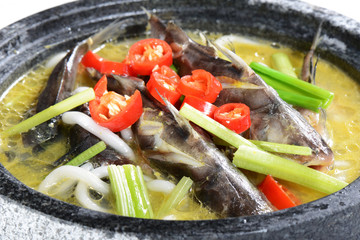 Chinese Food: Boiled fish in a stone pot