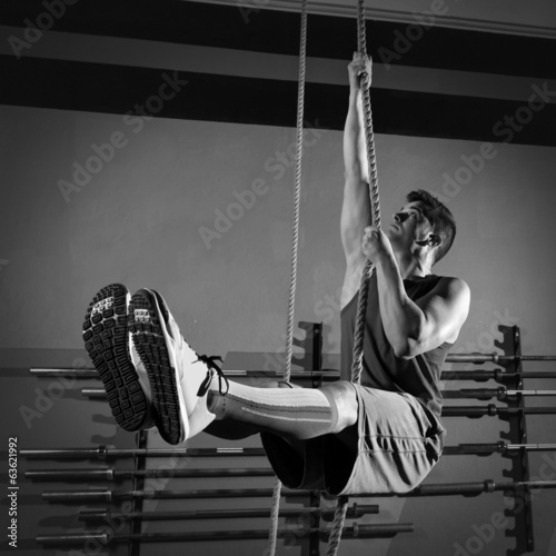 Rope Climb exercise man workout at gym