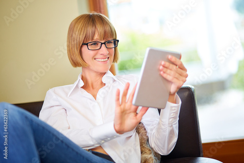 Woman with tablet at home