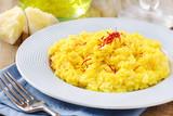 Italian saffron risotto decorated with red saffron threads