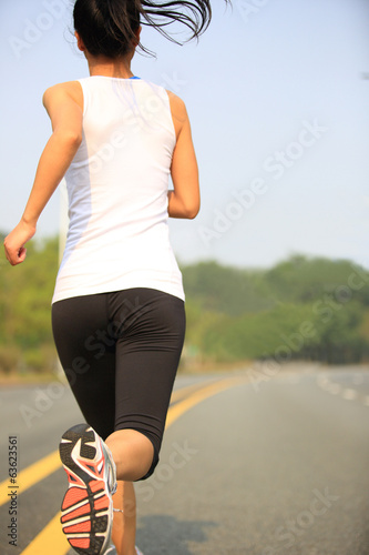 Runner athlete running on road