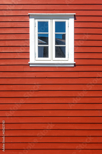 White wooden window on the red wooden house wall - 63623763