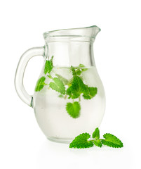 water with ice and mint in a glass jug