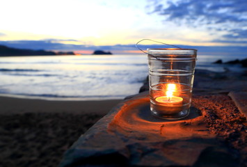 Candle on the beach