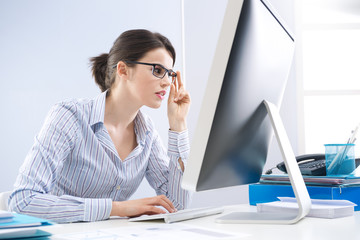 Office worker staring at computer screen