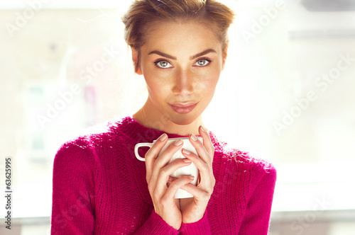 Portrait of attractive woman holding a cup