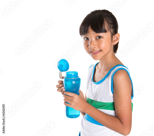 Young girl in sports attire with a bottle of water