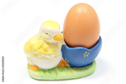 Easter chicken with fresh egg on white background