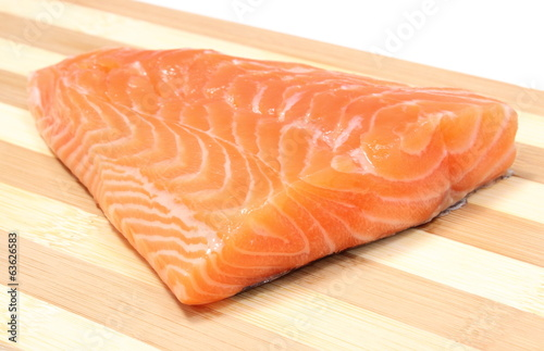 Closeup of salmon steak on wooden background