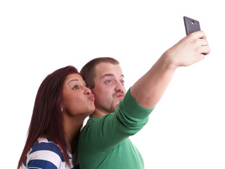 young couple taking selfie