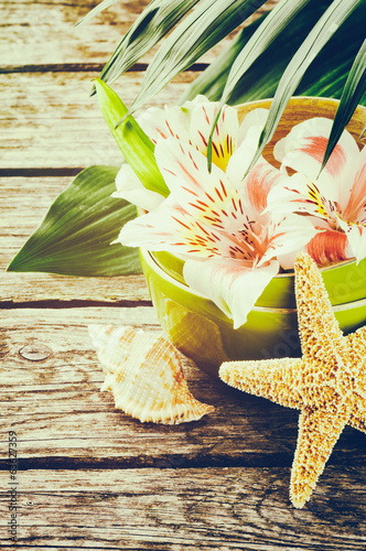 Summer holiday setting with tropical flowers