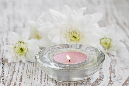 Candle and chrysanthemum