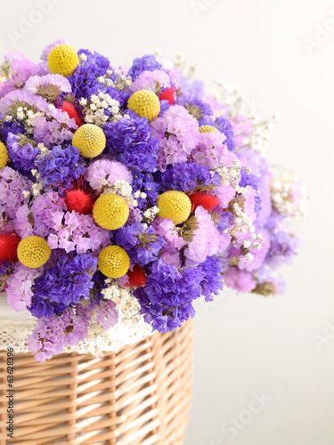 Close-up on the dried flowers with basket.