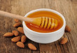 Honey dipper with almonds